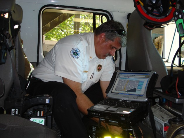 Chapel Hill Assistant Fire Marshall Dace Bergen on board a fire truck equipped with the RENCI-developed Automated Vehicle Location System.