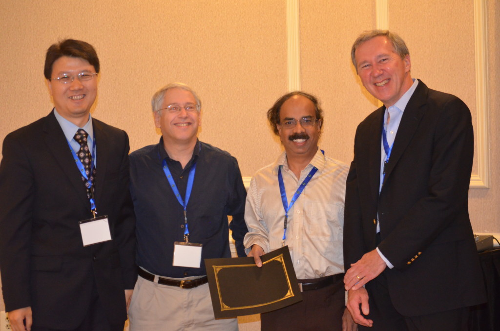 Paper authors (from right) Justin Zhan, Howard Lander, and Arcot Rajasekar with one of the conference's keynote speakers, Tom Mitchell of Carnegie Mellon's School of Computer Science.