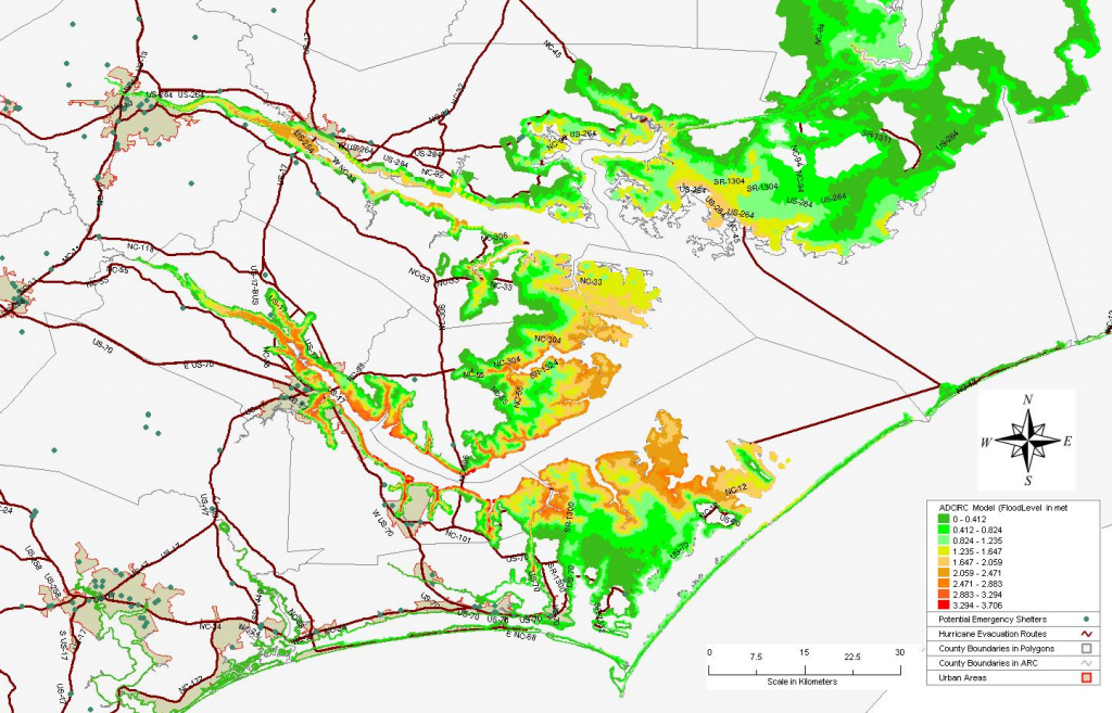 Storm surge inundation from Hurricane Isabel (2003) with evacuation routes and emergency management shelters (green dots).