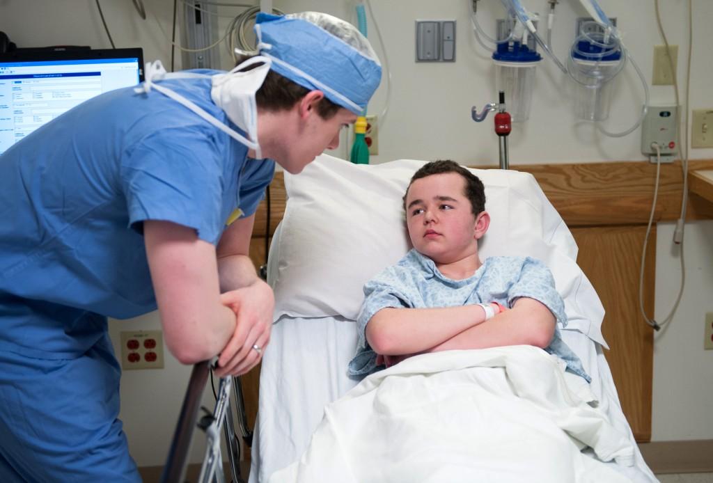 A doctor at Boston Children's Hospital checks on a young epilepsy patient during treatment. Photo credit: Katherine C. Cohen, Boston Children's Hospital
